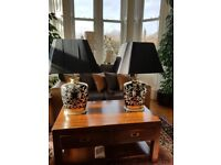 A pair of large table lamps for most rooms in the house.
