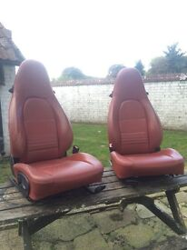 Red leather Porsche tombstone seats
