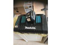 Makita dc18rd double charger and one 4.0 ah battery