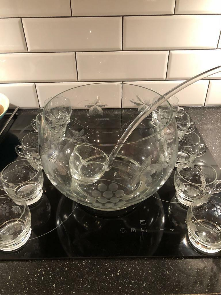 Punch bowl, ladle and ten glasses