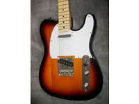 Telecaster Copy featuring a solid tone wood body, maple neck, a die-cast machine heads.