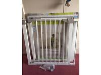 Two Lindam Sure Shut Orto safety gates with extensions.
