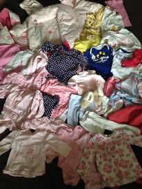 Large box of 6-9 months baby clothes. Variety of tops, legging, vest and baby grows