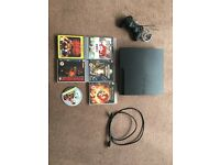 Playstation 3, cables, controller and 5 games