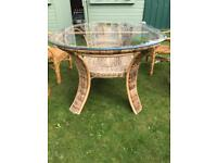 Cane conservatory table as new ( can deliver)