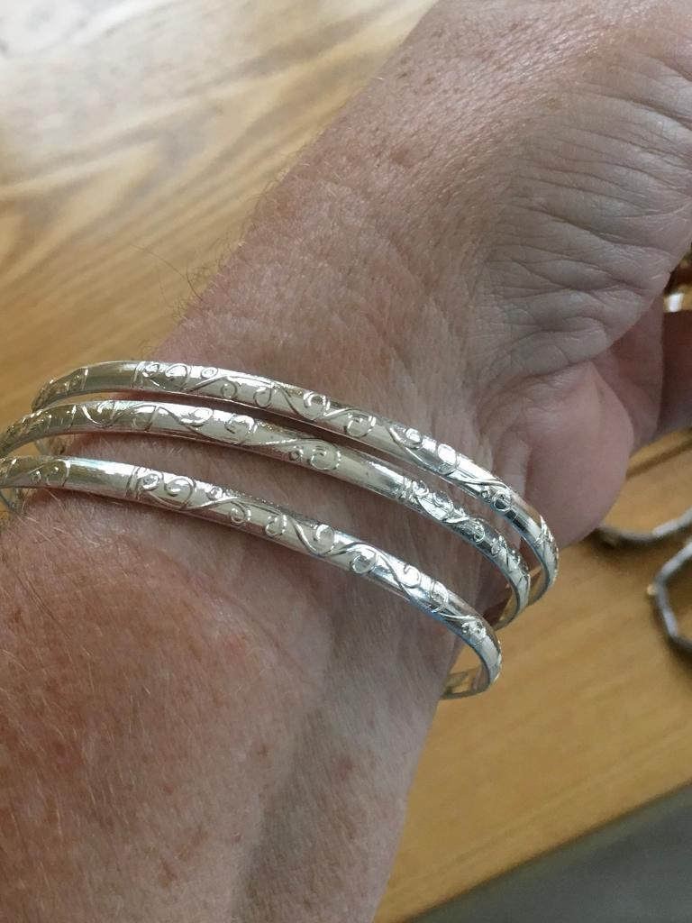 3 silver bangles with a nice engraved pattern new