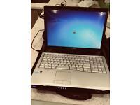 "Toshiba laptop p200 17"" screen ,carry bag windows 7 perfect fist laptop"