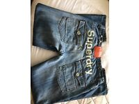 Designer SUPERDRY and POLICE Jeans. AS NEW. Size 34 x 34