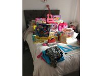 Job lot of toys, books, clothes and some furniture. Suitable for car boot.