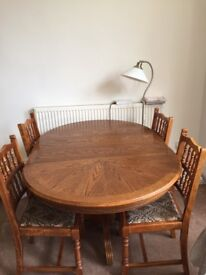 Moving sale: Good quality hardwood adjustable table with 4 chairs