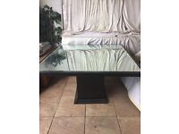 Dining table with mirror top