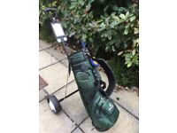 Set of left hand king cobra golf clubs and a set of Wilson Invex woods, bag and trolley