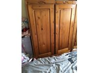 Pine double wardrobe with key and 2 storage draws built in