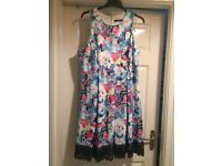 2 beautiful ladies dresses size 16/18 worn only once