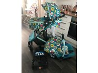 Cosatto travel system including car seat and isofix