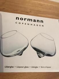 Stunning pair of brand new in box Normann Copenhagen rocking liqueur glasses.