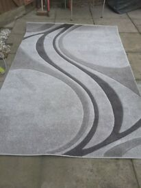 Silver rug good condition 91 inch 63inch