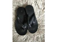 Size 5 black wedge flip flops