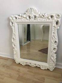 Mirror with decorative white frame