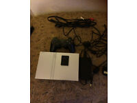 PS2 Console Silver Fully Working Good Used Condition. With 21 top Games, plug in & play.