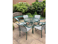 Garden Table with 6 chairs and Parasol. Excellent condition only £100