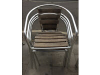 4 x Metal and wood stacking chairs . Great chairs , comfy. Free local delivery.