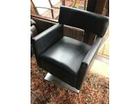 black leather rise and fall chair