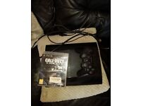 Black ps3 with COD ghosts