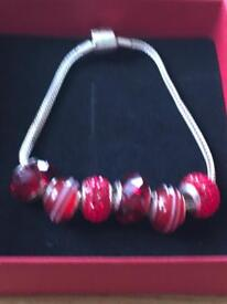 Genuine Rhona Sutton red charm bracelet brand new
