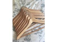 10 matching quality wooden hangers as new