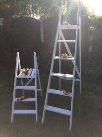 Matching white ladders