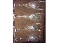 Set of four New crystal champagne glasses