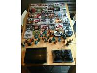 Ps3 slimline , 33 games , 2 wireless controllers , 25 skylander characters and 2 modules.