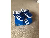 Toddler blue Adidas trainers