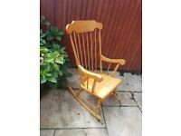 Beautiful high backed wooden rocking chair