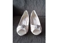 Ivory and diamanté wedding shoes.