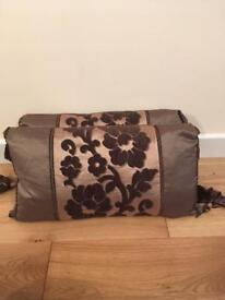Stunning pair of Laura Ashley brown cushions. Each measures 33cms by 60cms.