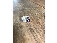 Solid silver ring with garnet - size J