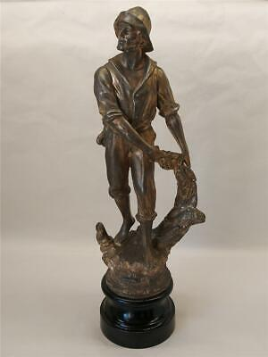 A vintage Spelter figure Statute of a  fisherman with Fish on Plinth