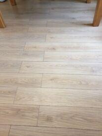Uniclick light oak laminate flooring and felt pad underlay boards