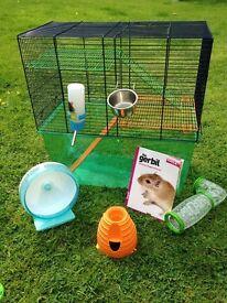 Hamster gerbil cage /gerbilarium. With wheel/bottle and book