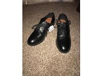 Black flat lace shoes. Size 5.5