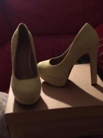 Heels plus one pair trainers