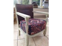 Antique chair upholstered in Andrew Martin fabric
