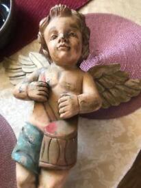 Wooden old cherub