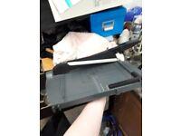 Guillotine paper cutter.