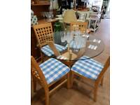 Glass top table and 4 chairs { newly recovered}