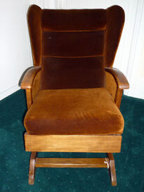 Small, adult sized, rocking, wing back armchair.
