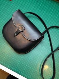 Handmade leather handbag messenger style moulded