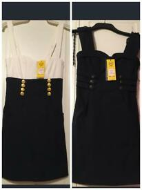 Two never worn dresses with tags still on!